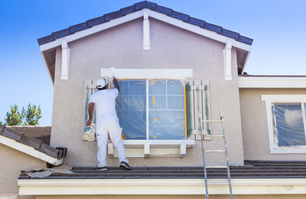 a painter painting a house